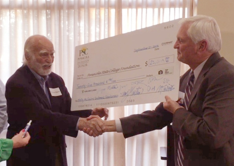 The Irish Politicians Club, a social club based at McGuire's Irish Pub, presented a $35,000 check to the College for the scholarship fund, which began in June 2015. Then McGuire Martin presented a $25,000 check to the endowment scholarship fund named for his late wife, who died in 2014.